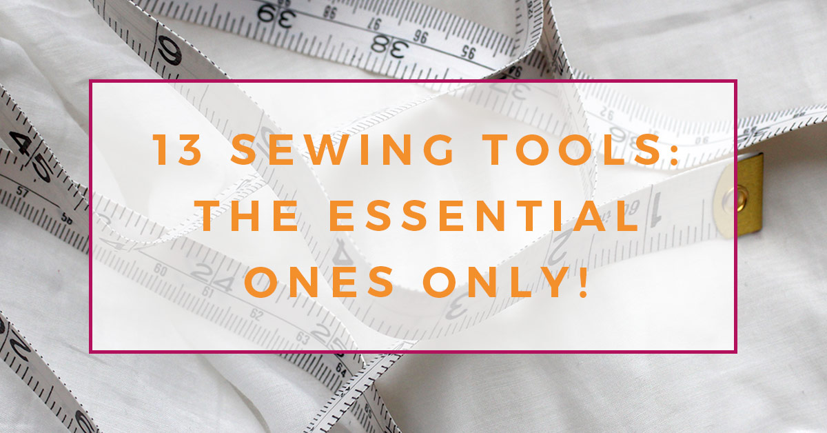White dressmaking tape measure on white fabric background. Image contains text overlay: 13 sewing tools, the essential ones only.