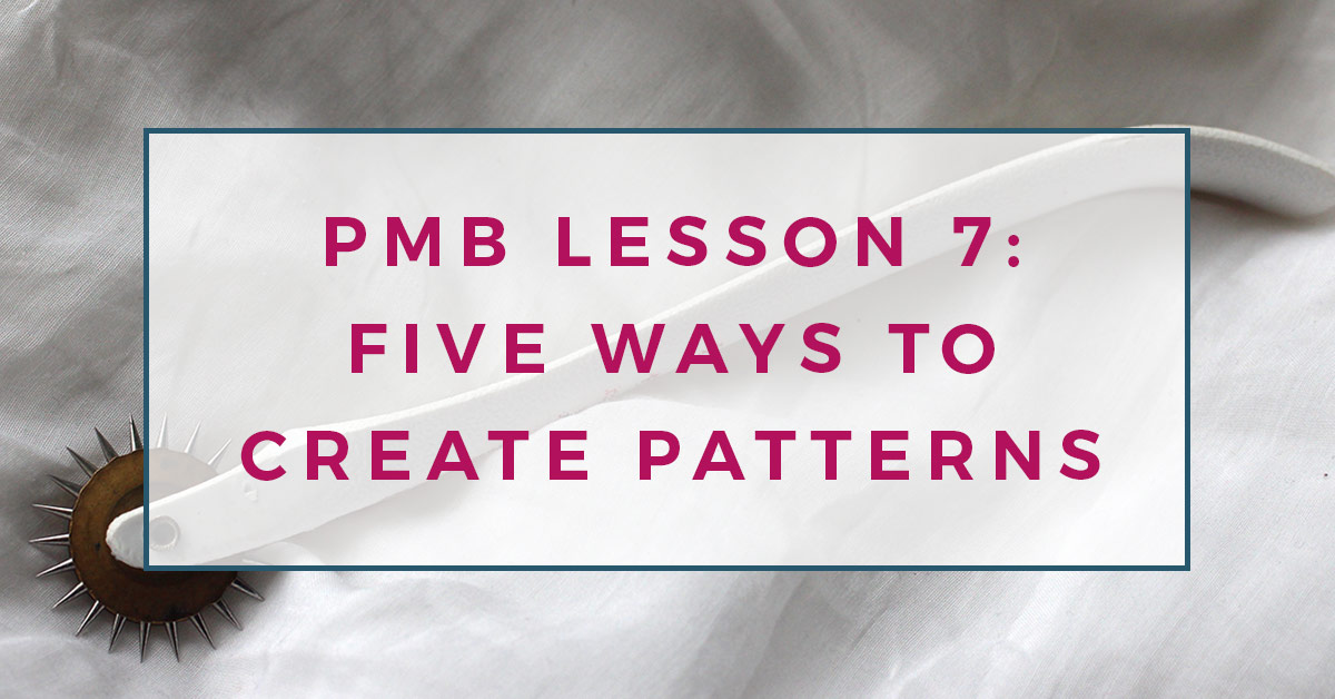 A tracing wheel tool used in pattern making, laying upon a white fabric background. There is a text overlay reading PMB lesson 7: five ways to create patterns